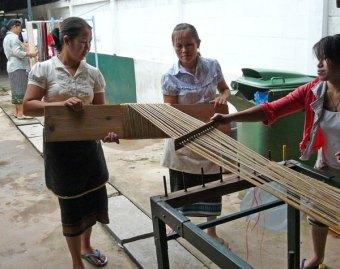 Weavers winding a warp.