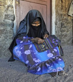A woman from the Jabaliya Bedouin tribe embroidering a bag.