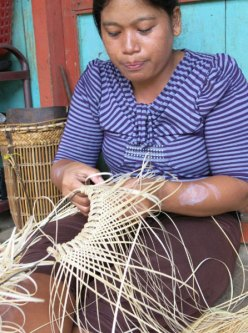 The anjat basket is started from the top and woven to the bottom.