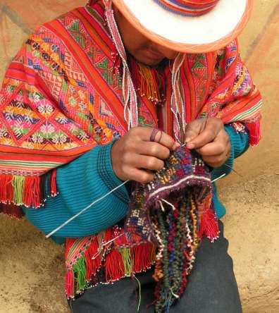 Note the strings of grutas hanging down from the hat.