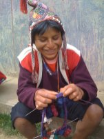 A young man from the Chahuaytire community knits a traditional hat.
