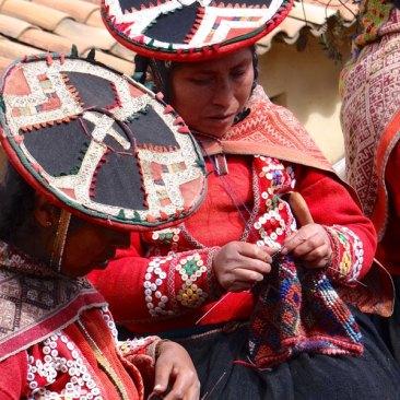 "Accha Alta women handknitting ""gruta"" hat on very small needles."