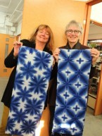 Linda Stark and Marilyn Murphy of ClothRoads show off their indigo clamped towels.