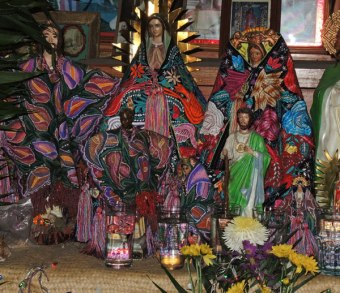 Statues clothed in layers of textiles.