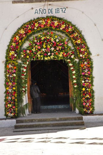 The entrance to San Lorenzo Church is festooned with flowers.