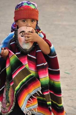 This young boy was ready to don his mask and headdress for the parade.