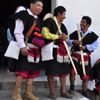 The front view of the men's traditional garments, complete with the carrying of a maguey fiber bag.