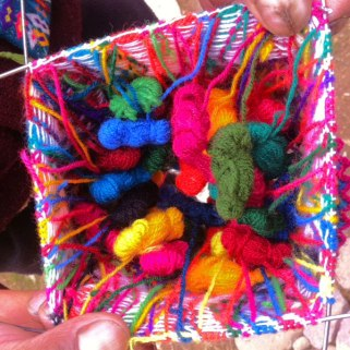 Inside view of the colorful yarn bobbins used for knitting the hats.