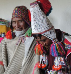 Santos, on left, wears the traditional hat and poncho. Benito, on right, has beaded his hat.