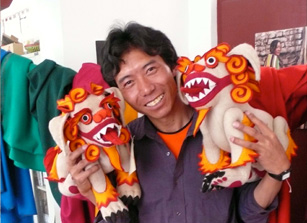 Tenzin, a Lhasa tailor with his first snow lions.