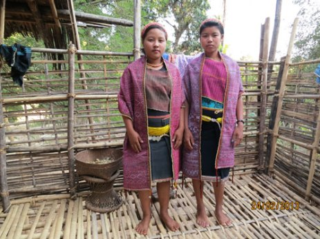 Chin weavers wearing finely handwoven garments. The shawls are supplementary pattern weaving.