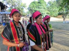 Women dressed in traditional festive garments.