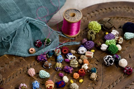 Various types of hand-knotted buttons.