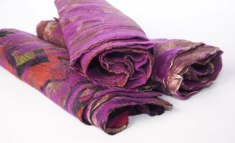 Rolls of the signature felted, vintage sari scarves.
