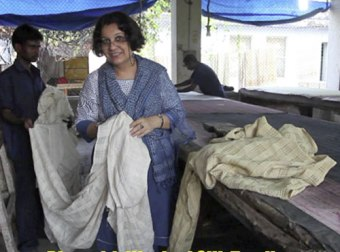Bina Rao holds her handwoven silk fabric, ready for dyeing.