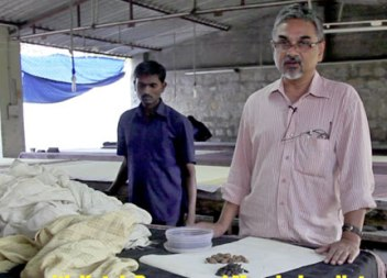 Kesav Rao (on right ) prepares the natural dyes for the next stage of cloth production.