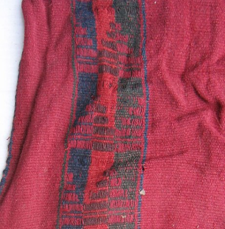 The fragment from the Chiribaya culture (AD 800-1100) shows the vibrant red used throughout the ancient times in the Andes. This culture existed in what is now southern Peru before the Inca came to power.