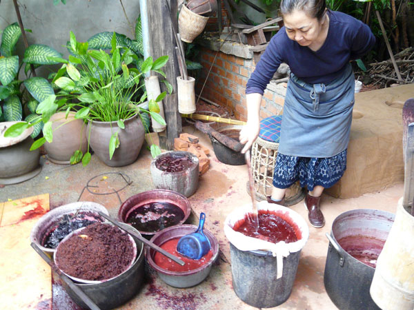 Various stages of lac extraction in Laos.