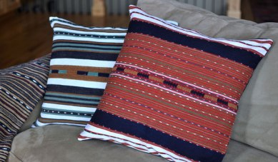 Naturally dyed and organic cotton pillows produced by artisan group.