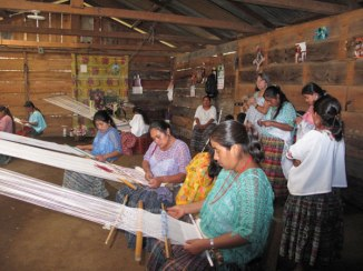 Olga working with backstrap weavers of Ixbalem Ke.