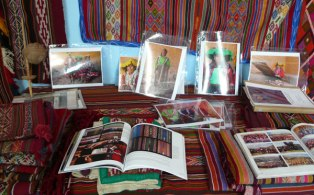 A wide range of traditional designs on display at Sallac weaving center.