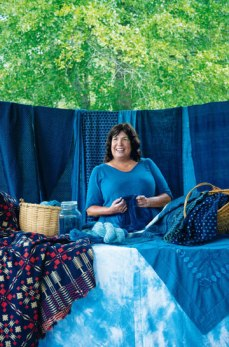 Donna Hardy with indigo-dyed products, all dyed using the indigo from the Lowcountry. Photo credit: Ruta Elvikyte, courtesy of charlestonmag.com/features/the_indigo_girl.