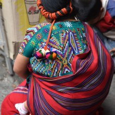 A weaver from Nebaj carries her baby the traditional way.
