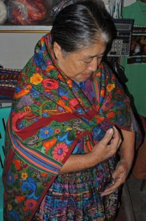 Herminia Santos shows off her reversible (double-sided) huipil.
