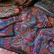 Colorful rugs hooked by the Multicolores women.