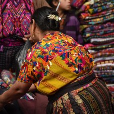 Embroidered huipil worn at early morning market in Chichicastenango.