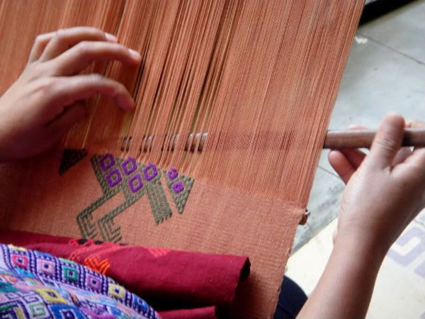 Brocade design being woven on backstrap loom. Photo credit Conozcamos Guatemala.