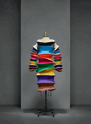Issey Miyake's Flying Saucer dress from 1994 is one of the few brightly colored pieces in the Met show. The dress, made of a series of wired fabric circles, collapses like an accordion, for easy storage!