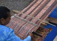 Ikat cloth being woven on backstrap loom in west Timor.
