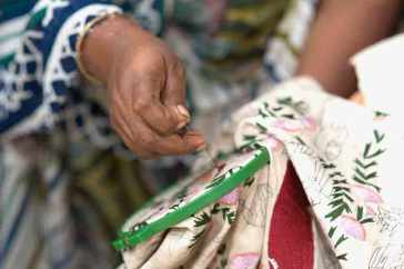 Hand stitching a kantha textile using a hoop. Photo courtesy of Kantha Productions LLC and Anil Advani, photographer.