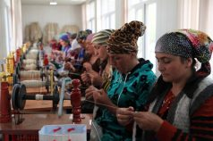 Women spinning together in their workshop.
