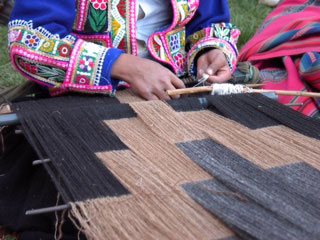 Scaffold weaving underway in the highlands of Peru. Photo courtesty of Center for Traditional Textiles of Cusco.