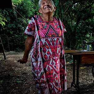 Juana Quioz Pérez wears a huipil with a design known as the Scarab Beetle Tree. Photo credit: Eric Mindling.