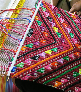 Weavers in Chinantla, Mexico, use gorgeous vivid colors. Photo credit: Tia Stephanie Tours