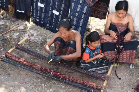 Ikat weaving and indigo dyeing are handed down through generations. The young child unties the wrapped threads after the dyeing.