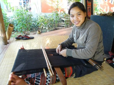 Mone Jouymany weaving on backstrap loom at Ock Pop Tok in 2011.