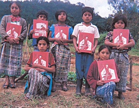 Maya children with coloring books.