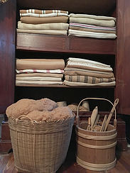Acadian brown cotton blankets, fiber and tools.