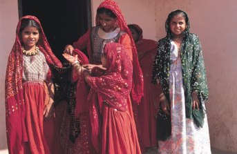Jat girls wearing traditional bandhani clothing for a ceremony. Photo courtesy Zakiya Adil Khatri.