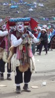 Masks and costumes add to the drama of an important festival.