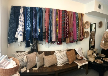 The studio features artisan-made textiles including scarves and home accessories from over 20 countries. All purchases help sustain an artisan and their family.