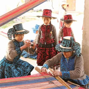 Youth from Chumbivilcas take photos of weaving elders in their community.
