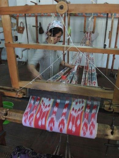 Uzbekistan ikat being woven on a floor loom.