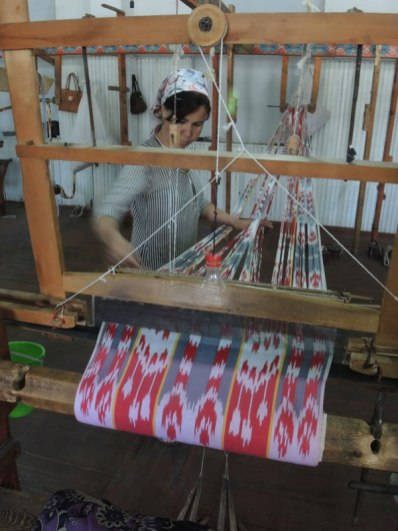 Uzbekistan ikat being woven on a floor loom.