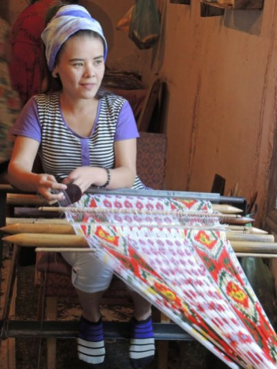 Setting up to weave an ikat satin cloth.