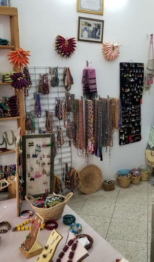 The cooperative store in Sefrou features an array of button jewelry plus some handwoven scarves and rugs.